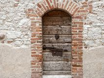 Free Weathered Wooden Old Entrance Door In Thick Stone Wall Royalty Free Stock Photography - 160518967