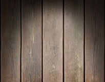 Weathered wooden plank background lit from above Stock Photos
