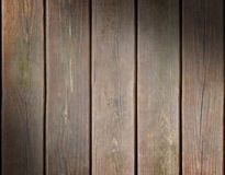 Weathered wooden plank background lit diagonally Stock Photography
