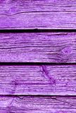 Weathered wooden plank painted in proton purple royalty free stock photography