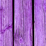 Weathered wooden plank painted in proton purple royalty free stock image