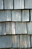Weathered Wooden Shingles. This is a close up image of the weathered wooden shingles on a house stock photography