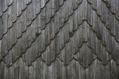 Weathered wooden shingles. Background of decorative weathered wooden shingles Stock Image