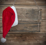 Weathered wooden sign. With Santa hat Stock Image