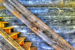 Weathered wooden steps and log cabin wall HDR. Stock Photo