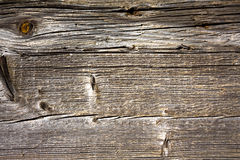 Weathered wooden surface with knots and cracks Royalty Free Stock Images