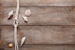 Weathered wooden table background with rope Stock Images