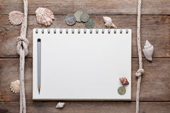 Weathered wooden table with blank notepad Stock Photos