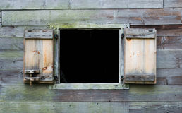 Weathered wooden wall with open window on colonial barn Stock Images