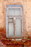 Weathered wooden window on brick wall Stock Photos