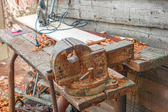Weathered workbench with rusty metal clumpink Royalty Free Stock Photography