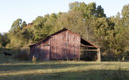 A weathered and worn barn. Stock Image