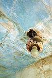 Weathered and worn interior with light fixture stock image
