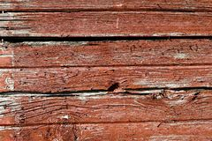 WEATHERED WORN RED BARN WOOD SIDING. The siding of a barn shows the weathered effects of years of rain , snow and wind stock photos