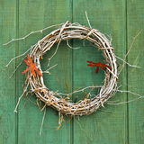 Weathered woven vine wreath Stock Photo