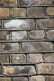 Weathered yellow brick wall texture background. Weathereed old brick wall with stain and paint Stock Photo