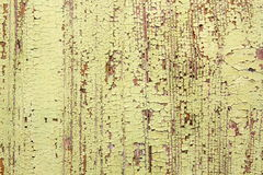 Weathered yellow paint surface on wood Stock Photography