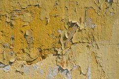 Abstract background of cracked and peeling yellow paint royalty free stock photo