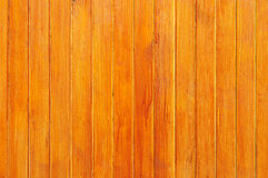 Weathered yellow-red painted wooden boarding Royalty Free Stock Photography