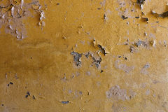 Weathered yellow wall with stains Royalty Free Stock Photos