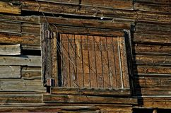 WeatheredDoor to a Hayloft. An old weathered  barn or stable door is an opening to a hayloft or  second story level Royalty Free Stock Images