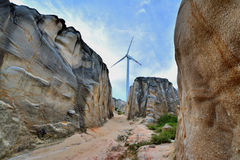 Weathering granite canyon and windmill. Weathering and decayed granite and windmill in Fujian, South of China, as featured geology landforms, and energy industry Stock Photo