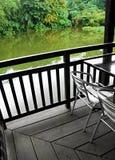 Weatherproof wood deck patio over pond Stock Photos