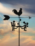 Weathervane against cloudscape Stock Photography