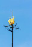 Weathervane in the form of ship over blue sky Stock Photo