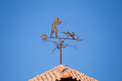 Weathervane on a roof top Stock Photos