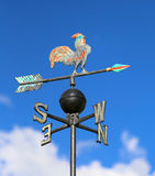 Weathervane with rooster above an arrow and the four cardinal p Royalty Free Stock Photography