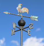 Weathervane with rooster above an arrow and the four cardinal p Royalty Free Stock Images