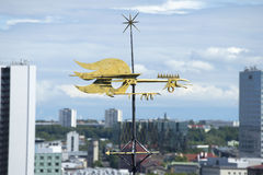 Weathervane-rooster on modern Tallinn Stock Image