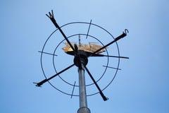Weathervane sous forme de rose des vents avec un chiffre d'un SH photo stock