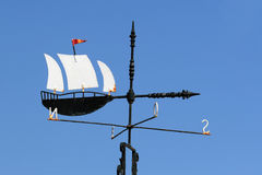 Weathervane yacht. Vane with the image of the sailing yacht indicating the direction of the wind Royalty Free Stock Photo