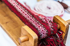 Weave. Some traditional sewing and knitting tools in a medieval fair Stock Photo