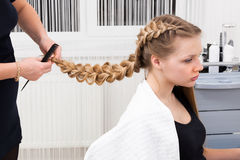 Weave braid girl. In a hair salon Royalty Free Stock Photography