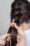 Weave braid girl in a hair salon Royalty Free Stock Photo