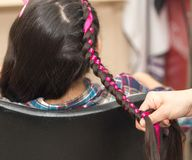 Weave braids in a beauty salon. Photo in the studio Stock Photo