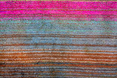 The weave of fabric closeup. The weave multicolored threads of fabric closeup Royalty Free Stock Photo