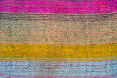 The weave of fabric closeup. The weave multicolored threads of fabric closeup Royalty Free Stock Images