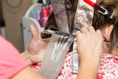 Weave hair in a beauty salon Royalty Free Stock Image