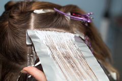 Weave hair in a beauty salon Royalty Free Stock Photo