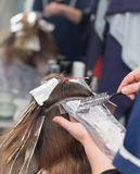 Weave hair in beauty salon Royalty Free Stock Images