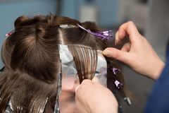 Weave hair in a beauty salon. Photos in the studio Royalty Free Stock Photography