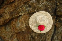 Weave Hat. With red flower Royalty Free Stock Image