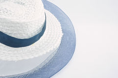 Weave hat fray. White and blue Weave hat for woman fray on white background Royalty Free Stock Photography
