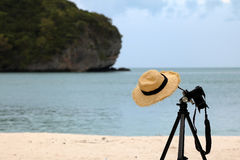 Weave Hat hanging on a tripod on the beach. Weave Hat hanging on a tripod on the beach in Thailand Royalty Free Stock Image