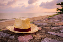 Weave hat near at the beach. Vintage tone Royalty Free Stock Photo