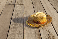 Weave hat. Old weave hat on the wood floor Royalty Free Stock Photography